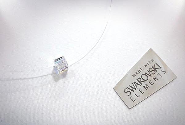 Colgante punto de luz con Cristal Swarovski.
