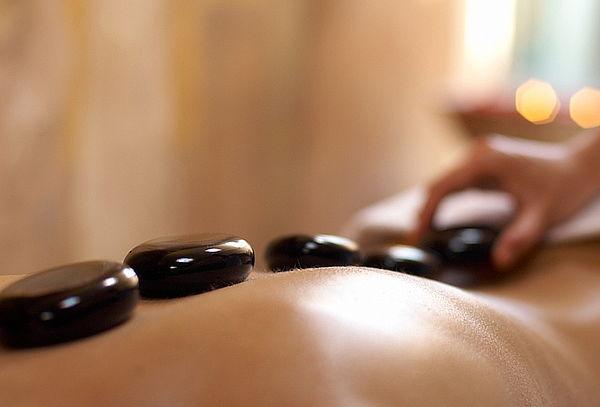 Masaje Descontracturante + Relajación con Piedras Calientes