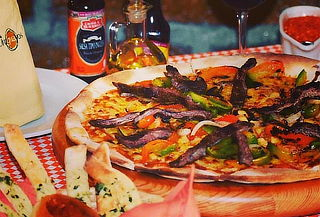 Elige entre 1, 2 ó 4 pizzas de especialidad a elegir + ENVÍO