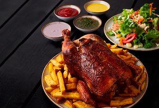 1 Pollo a la Brasa + Papas + Bebida con opción a Ensalada